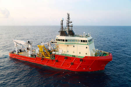 Supply boat operation shipping any cargo or basket to offshore. Support transfer any cargo to offshore oil and gas industry, Supply cargo or transfer passenger for work. Stock Photo - 38697269