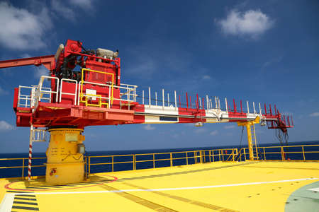 offshore jack up rig: Crane construction on Oil and Rig platform for support heavy cargo, Transfer cargo or basket on work site, Heavy industry. Stock Photo