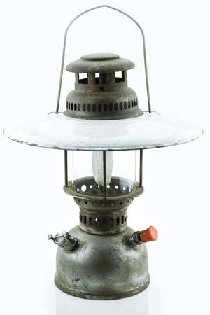 Old or vintage hurricane lamp on white background, Material corrosion of lamp material.