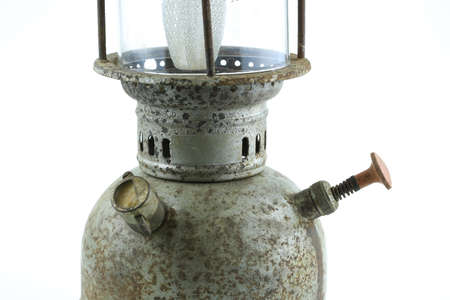 pressured: Old or vintage hurricane lamp on white background, Material corrosion of lamp material.