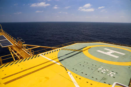 helideck: Helideck of oil and gas drilling rig in offshore industry, Helicopter landing area on construction platform in offshore of oil and gas industry or energy business for transfer passenger.