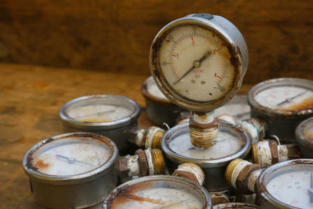 atmospheric pressure: Old pressure gauge or damage pressure gauge of oil and gas industry on wooden background, Equipment of production process.