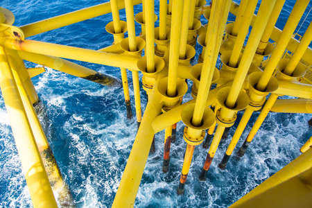 producing: Oil and Gas Producing Slots at Offshore Platform, Oil and Gas Industry. Well head slot on the platform or rig. Production and Explorer industry.