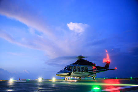 helideck: helicopter parking landing on offshore platform. Helicopter transfer crews or passenger to work in offshore oil and gas industry.Night flight training of Pilot and coordinate pilot.