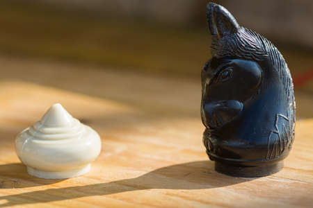 uniqueness: Chess pieces on wooden table, Planing game. chess uniqueness concept on the wooden background.