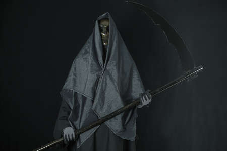 Messenger: Halloween concept and background, Messenger of death with pumpkin in Halloween, Ghost with black background.