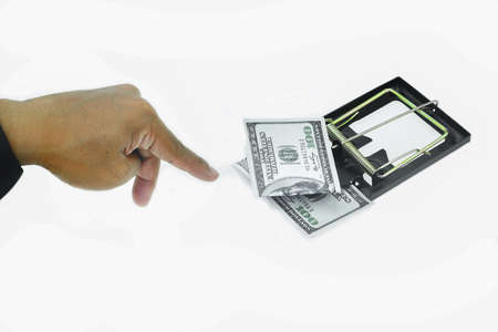finesse: Trap with dollar bills isolated over white background, Risk in business, Businessman taking money from a mousetrap.