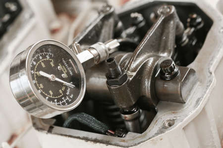 exhaust valve: Technician performs adjusting Rocker arm of exhaust valve and intake valve, Pressure tested for cylinder of the engine. Checked clearance or gap between the end of valve and rocker arm.
