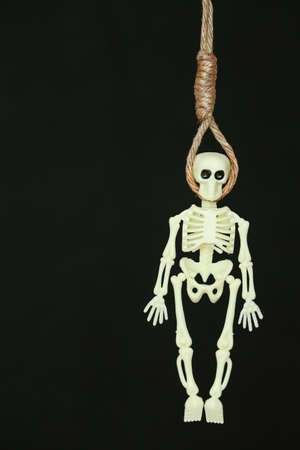 exhaustive: bankrupt concept, rope noose with hangmans knot hanging in front, Halloween background. Stock Photo