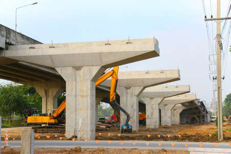 tollway installation work by construction worker and controlled by civil engineering, hard work and heavy lift by crane, Construction site with many engineering and worker.
