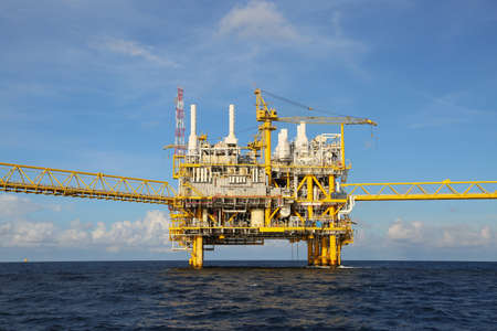industry: Offshore construction platform for production oil and gas, Oil and gas industry and hard work, Production platform and operation process by manual and auto function.