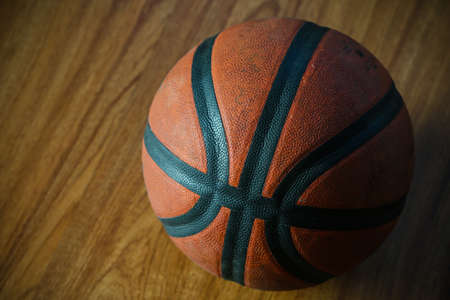 tourney: basketball on court or wooden, popular sport with team, sport background and empty area for text.