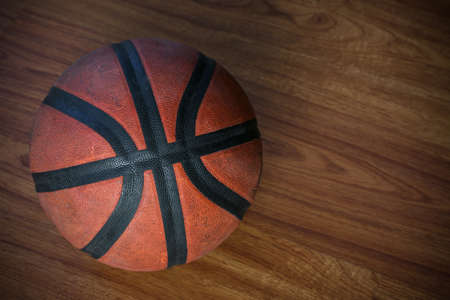 basketball on court or wooden, popular sport with team, sport background and empty area for text.