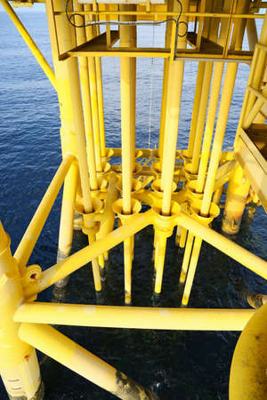 producing: Oil and Gas Producing Slots at Offshore Platform, Oil and Gas Industry. Stock Photo