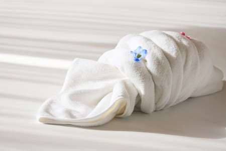 private room: Creative towel on the bed in the hotel, towel set prepare for use in private room, equipment in rent room or hotel.