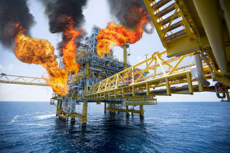 the worst: offshore oil and gas fire case or emergency case in warm picture style, firefighter operation to control fire on oil and gas production platform, offshore worst case and cant control fire