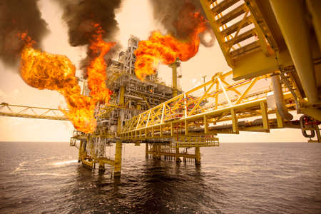 worst: offshore oil and gas fire case or emergency case in warm picture style, firefighter operation to control fire on oil and gas production platform, offshore worst case and cant control fire