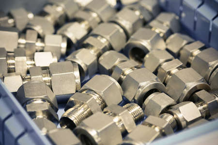 machined: Old bolts or dirty bolts on wooden background, Machine equipment in industry work. industry equipment and tools for work. Stock Photo