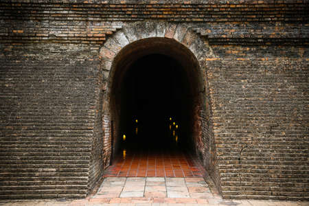 confined space: tunnel background and business concept. tunnel with old brick.