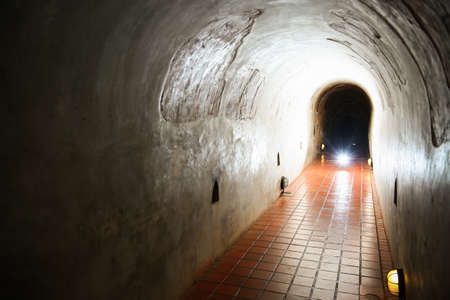 confined space: tunnel background and business concept. tunnel with old brick. the end of tunnel and concept business successfully. mystery tunnel or mystery way. tunnel damaged and waited for repair.