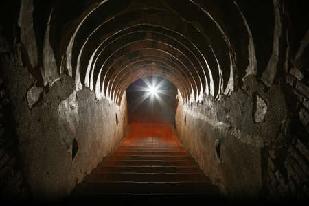 tunnel background and business concept. tunnel with old brick. the end of tunnel and concept business successfully. mystery tunnel or mystery way. tunnel damaged and waited for repair.