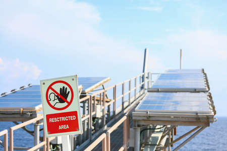 production area: Offshore construction platform for production oil and gas, Oil and gas industry and hard work, Production platform and operation process by manual and auto function. restricted area or danger area. Stock Photo