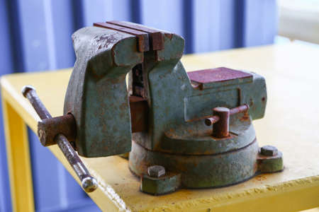 vise: Vise tool in workshop or the garage for support hard work, Special tools for industry job, vise stand on the table with other basic tool, Hand tool on table for service and repair in industry job. Stock Photo
