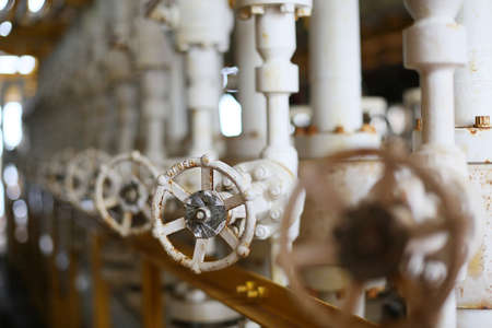 Valves manual in the production process. Production process used manual valve to control the system, Operator open and close or function the valve for controlled pressure or gas and oil flow rate. Stock Photo