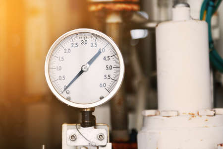 Pressure gauge using measure the pressure in production process. Worker or Operator monitoring oil and gas process by the gauge for routine record and analysis oil and gas production process. Foto de archivo
