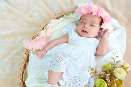 New born baby sleep on the basket or on the bed and keep smile with everyone.