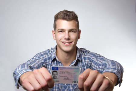 drivers license: Young man just recieved his drivers license and is happy to drive his own car soon