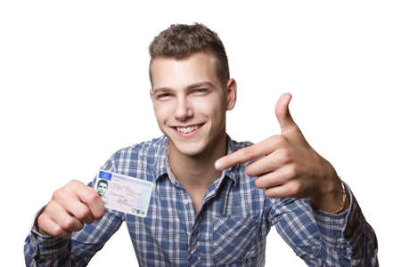 Young man just recieved his drivers license and is happy to drive his own car soon