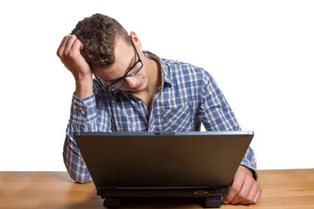 technophobe: Bored Boy has no success at the computer and gets an error message Stock Photo