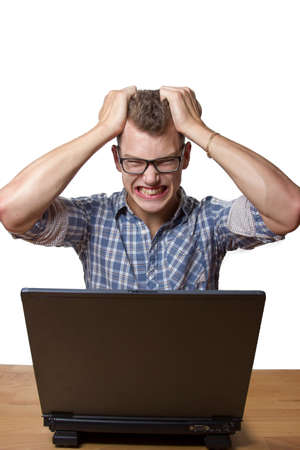 technophobe: Frustrated boy is sitting at the computer and gets aggressive