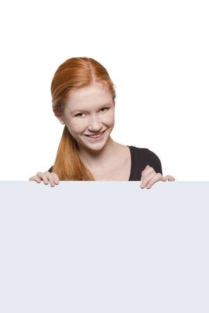 cute teen girl: Cute teen girl holding a white sign