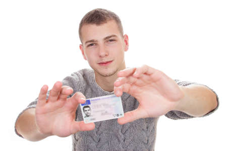 16 to 18 year old boy just received his driver license photo
