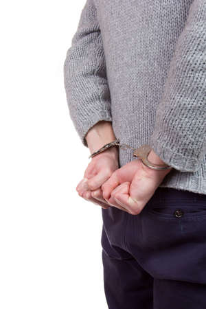 restraining device: Teenager wearing handcuffs and is caught by the police