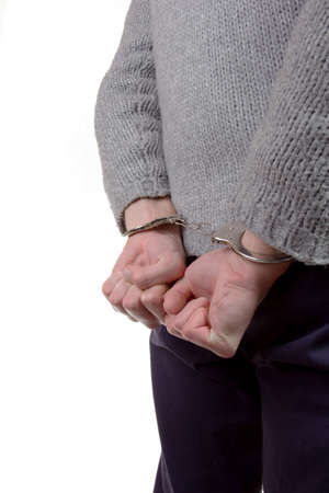 Teenager wearing handcuffs and is caught by the police photo