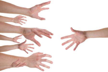 grabbing: Several caucasian hands reaching for the helping hand Stock Photo