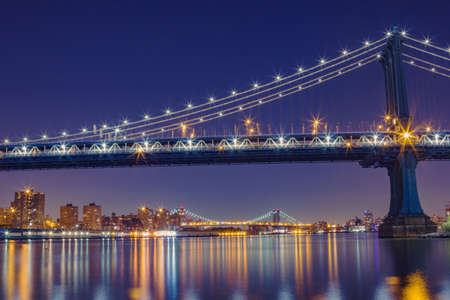 Long time exposure of the Manhattan Bridge during the night in New York City Stock Photo