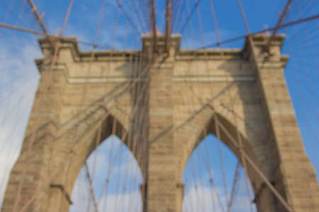 Great Brooklyn Bridge Background out of focus with blue sky Stock Photo