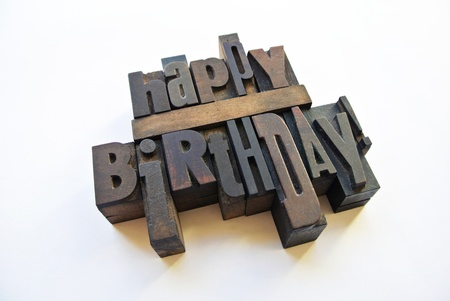 woodtype: Happy birthday message with wood typography