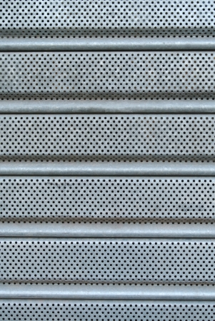 iron curtain: Micro hole patterned grey metal curtain texture