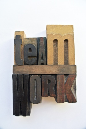 Woodtype letters forming teamwork word photo