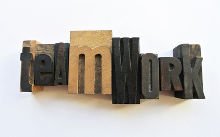 woodtype: Woodtype letters forming showing teamwork
