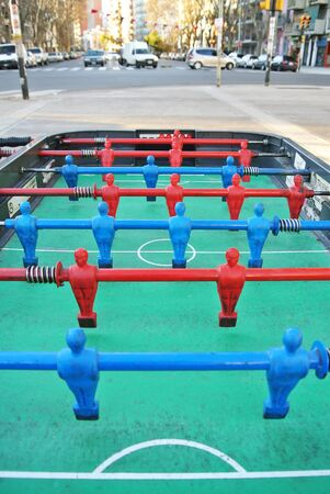 foosball: Worn out classic foosball table Stock Photo