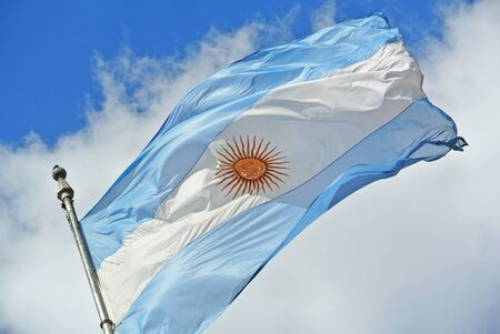 argentinean: Argentinean flag waving in the sky at Plaza de Mayo