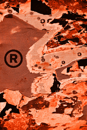 glued: Photo of urban collage paper texture with trademark symbol or icon