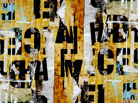 Digital collage of random letter texture on torn paper signs Imagens