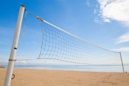 beach volleyball: A beach volleyball net on the beach with a clear and sunny sky